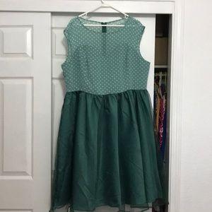 Lindy Bop taffeta dress is soft mossy green,l